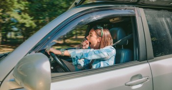 bigstock-Tired-young-woman-driving-car-111971066